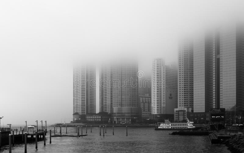 Panoramic view of coastline, harbour bay with Promenade and Skyscrapers of Hanwha Resort Haeundae on a foggy day. Haeundae-gu,. Haeundae Beach is the most famous royalty free stock images