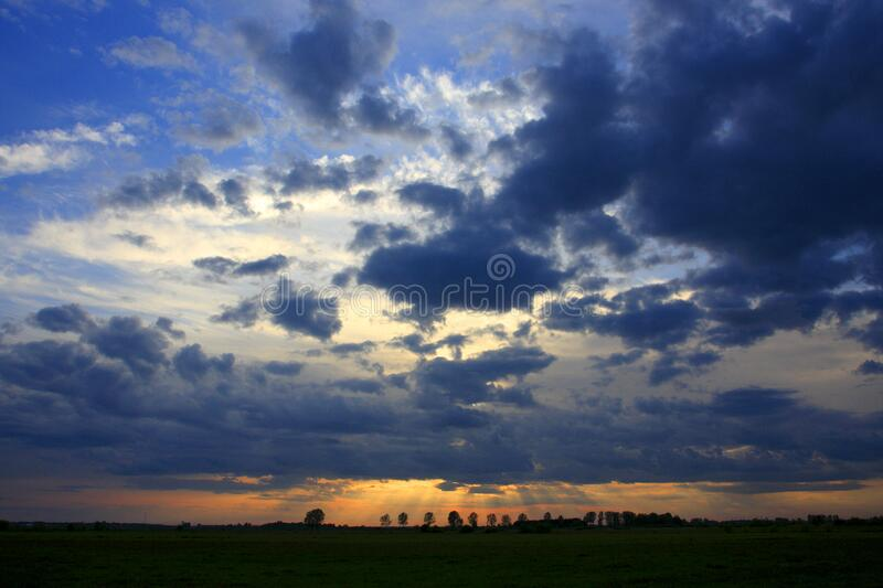Panoramic view of colorful sunset over wetlands and meadows wildlife refuge by the Biebrza river in Poland stock photo