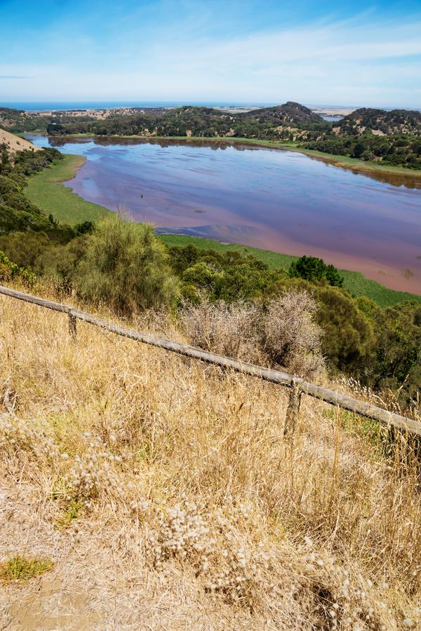 Panoramic view on coloured lake with grassland. Tower Hill Wildlife reserve park. Victoria, Australia royalty free stock images