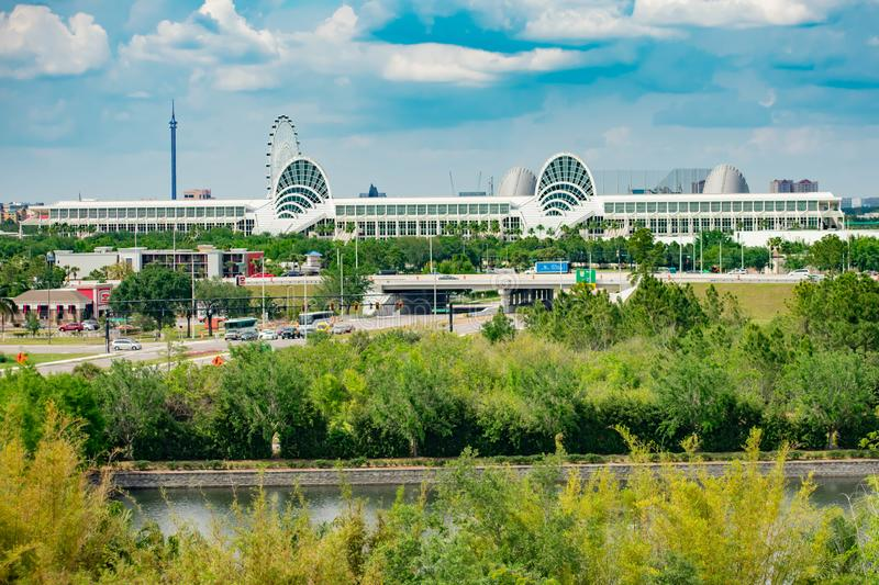 Panoramic view of Convention Center on lightblue sky cloudy background in International Drive area . Orlando, Florida. April 7, 2019.  Panoramic view of stock image