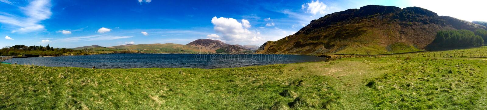 Panoramic view of countryside lake stock images