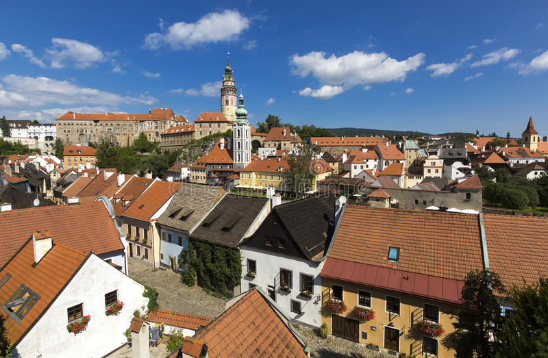 Panoramic view of Czech city Cesky Krumlov. European tile roof houses, a river and a bridge over it full of people in South royalty free stock photography