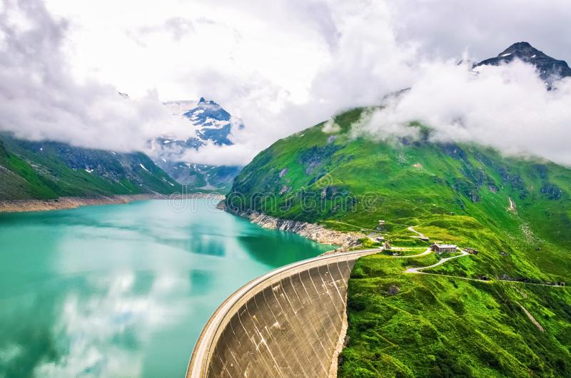 Panoramic view of dam at alpine mountains in Austria royalty free stock photography