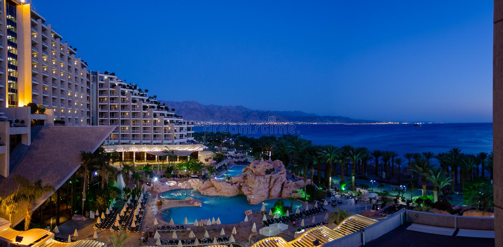 Panoramic view of Dan Hotel and Red Sea at blue hour time, Eilat city, Israel. EILAT, ISRAEL - SEPTEMBER 21, 2012: Panoramic view of Dan Hotel and Red Sea at royalty free stock images