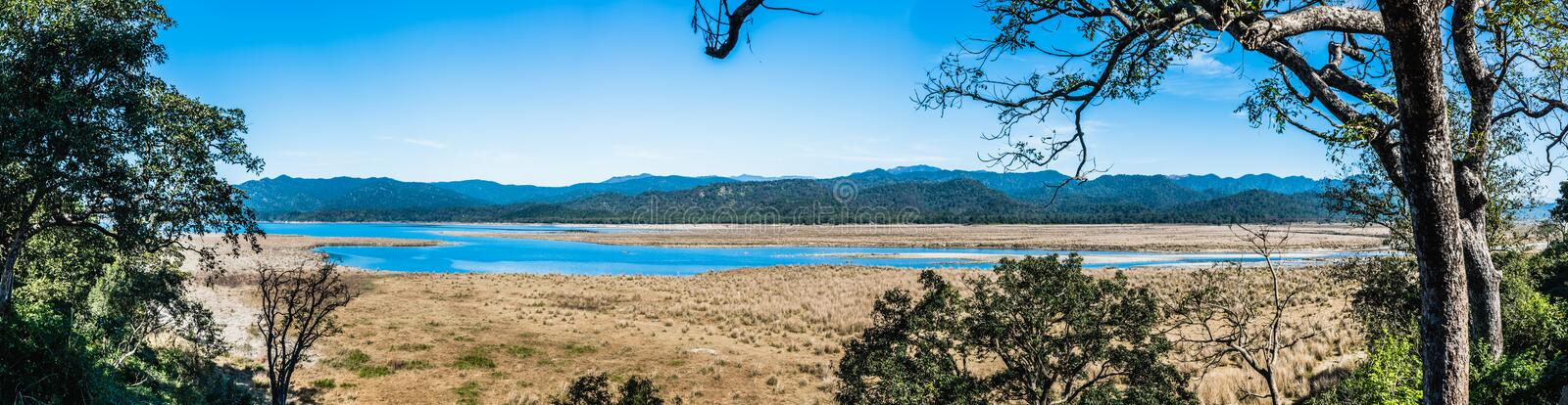 Panoramic view from Dhikhala forest rest house at Jim Corbett National Park. Panoramic view of River Ramganga flowing over Dhikhala, at Jim Corbett National Park royalty free stock image