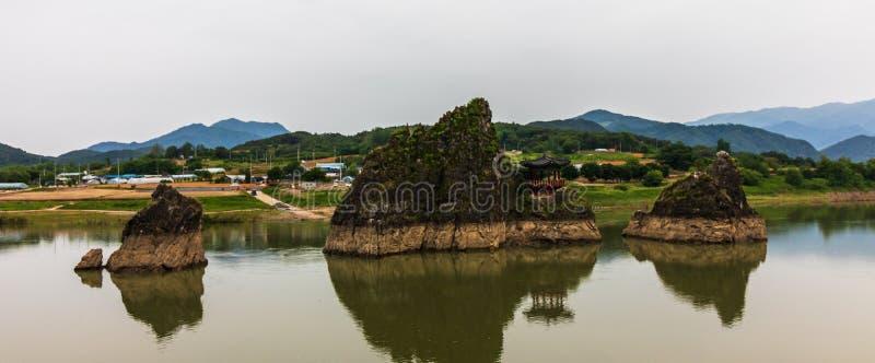 Panoramic view on Dodamsambong Peaks. Three stone peaks rising out of the Namhangang River. Danyang, North Chungcheong, South. Eulwangni Beach in Incheon, Sokcho royalty free stock image