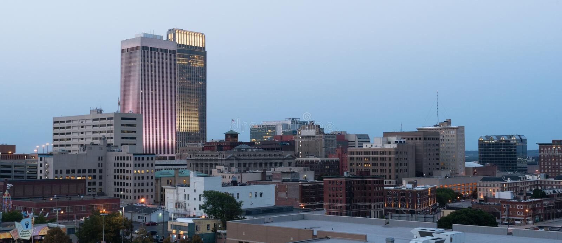 Panoramic View Downtown Omaha Nebraska City Skyline. Night falls on the heart of the USA in Omaha stock photography