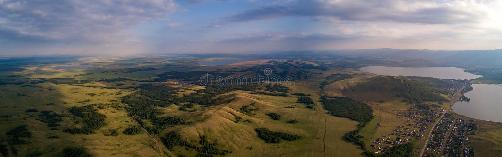 Panoramic view from drone of the fields near mountains stock photos