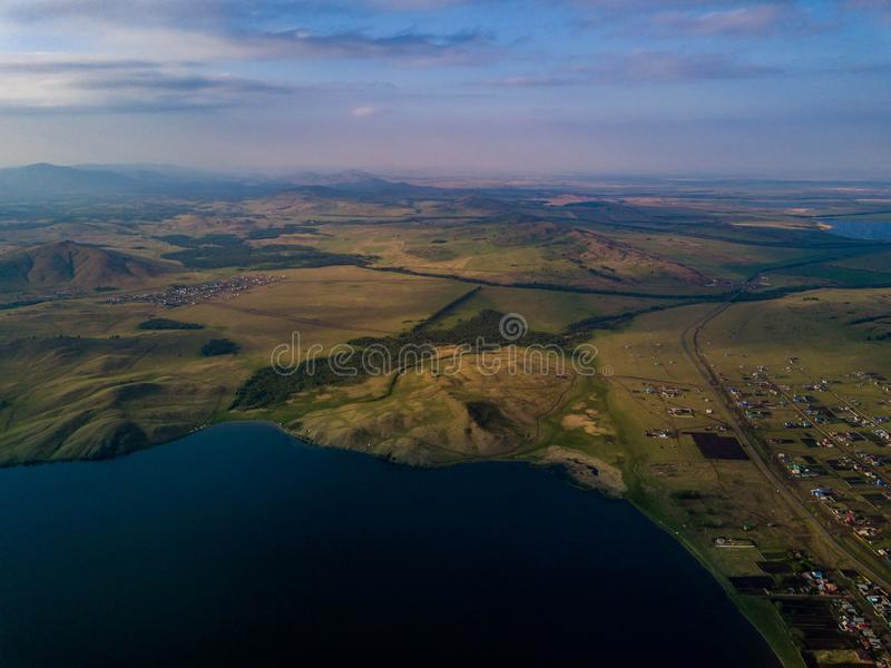 Panoramic view from drone of the lake near the mountains stock images