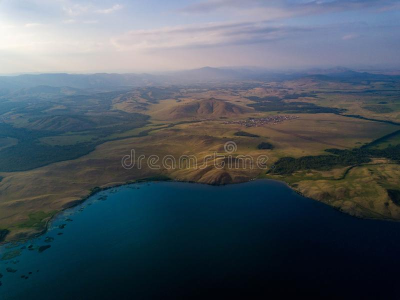 Panoramic view from drone of the lake near the mountains stock photos