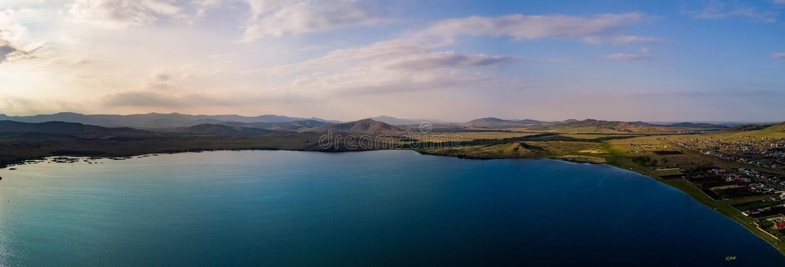 Panoramic view from drone of the lake near the mountains royalty free stock images