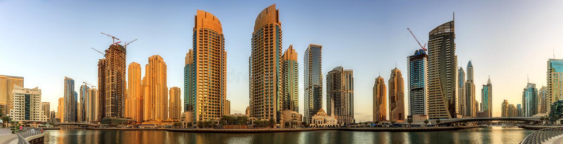 Panoramic view of Dubai Marina bay with yacht and cloudy sky, Dubai, UAE royalty free stock photo