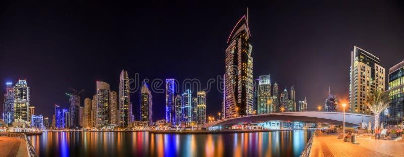 Panoramic view of Dubai Marina bay with yacht and cloudy sky, Dubai, UAE stock photos
