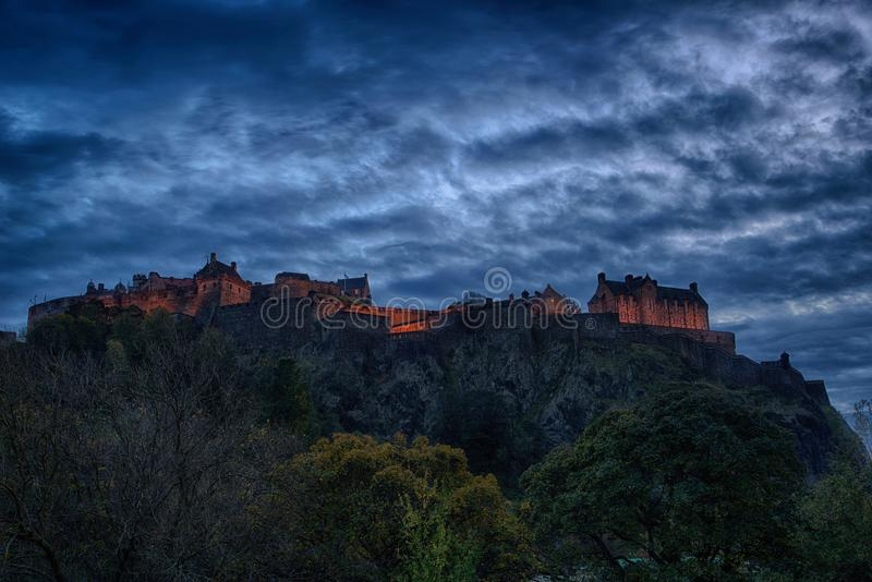Panoramic view of Edinburgh Castle at Night. Edinburgh Castle at night under a blue gloomy sky