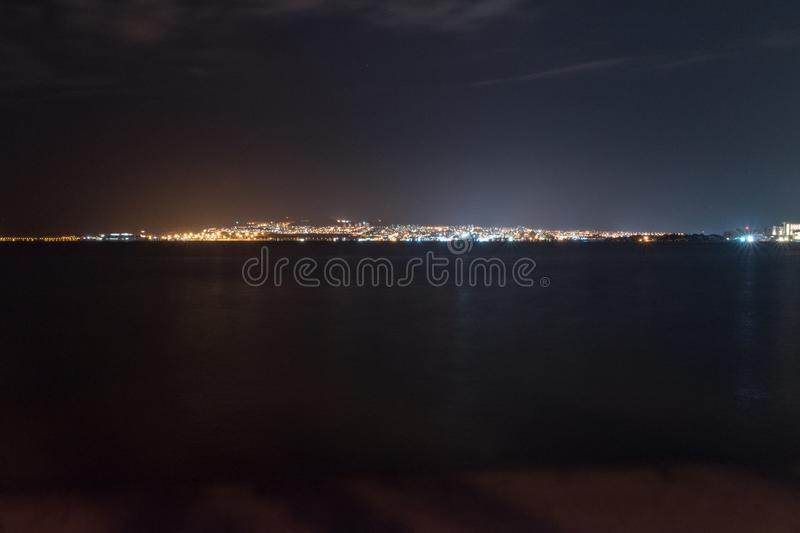 Panoramic view of Eilat in Israel from Aqaba in Jordan at night royalty free stock photo