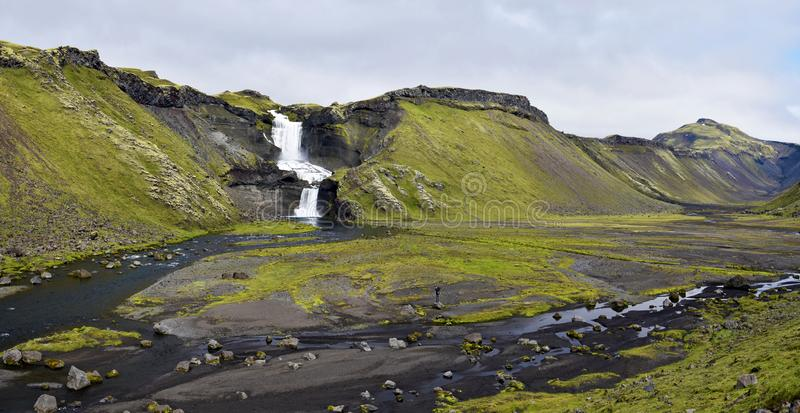 Panoramic view of Eldgja Canyon floor with the flow of Nordari-Ofaera river and Ofaerufoss waterfall in southern highlands of stock photography