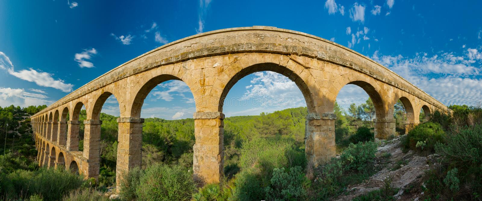 Panoramic view of the entire roman Aqueduct Pont del Diable in Tarragona stock photos