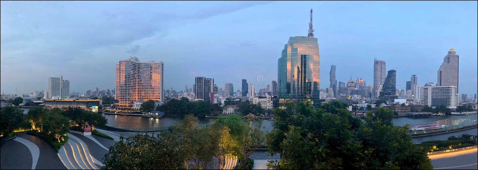 Panoramic view of evening Bangkok, sunset reflected in the windows of skyscrapers along the Chao Phraya River stock images
