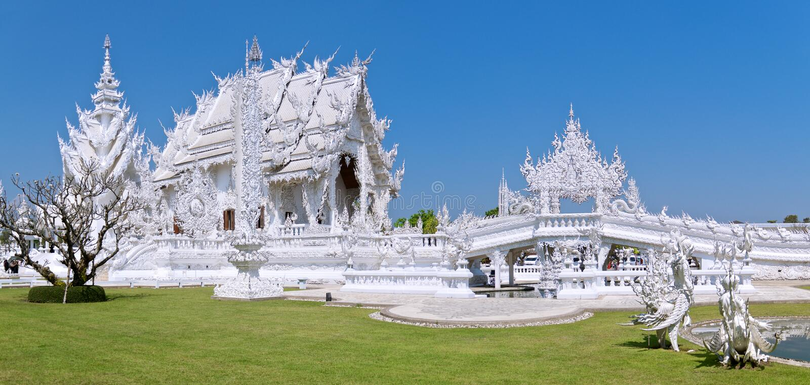 Panoramic view of the famous amazing White Buddhist temple against the blue cloudless sky stock images