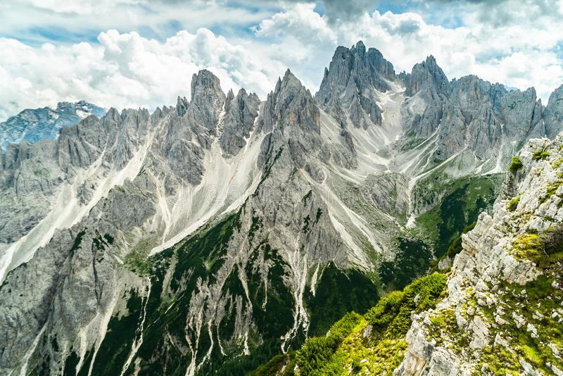 Panoramic view of famous Dolomites mountain peaks glowing in beautiful golden evening light in summer, South Tyrol, Italy. Dolomit. Es Landscape. View from the royalty free stock photo