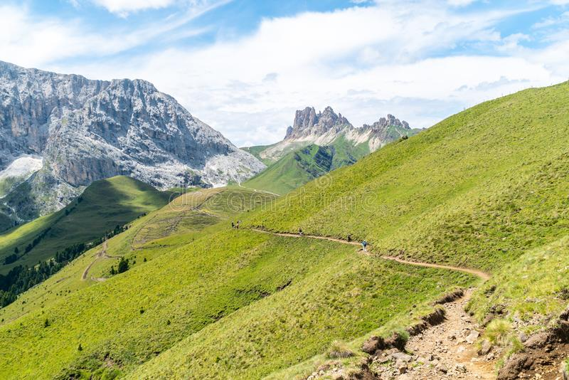 Panoramic view of famous Dolomites mountain peaks glowing in beautiful golden evening light in summer, South Tyrol, Italy. Dolomit. Es Landscape. View from the stock image