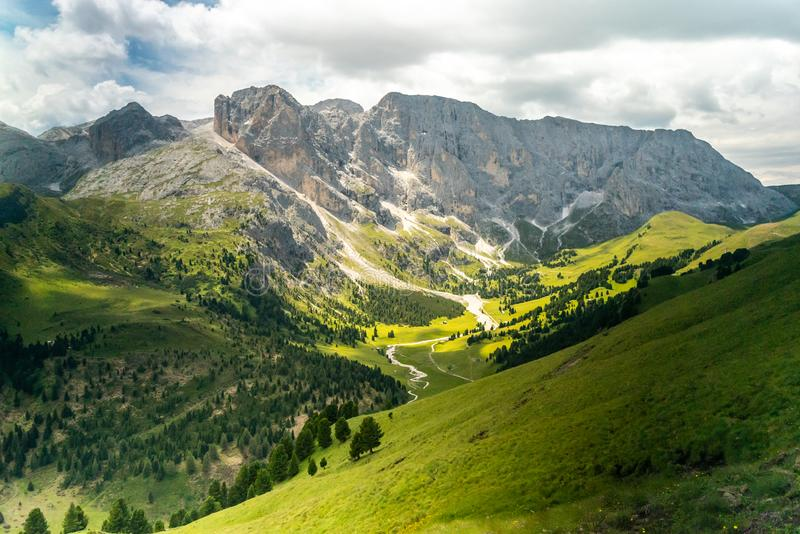 Panoramic view of famous Dolomites mountain peaks glowing in beautiful golden evening light in summer, South Tyrol, Italy. Dolomit. Es Landscape. View from the royalty free stock photography