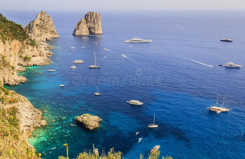 Panoramic view of famous Faraglioni Rocks, most visited travel attraction of Capri Island, Italy. stock photo