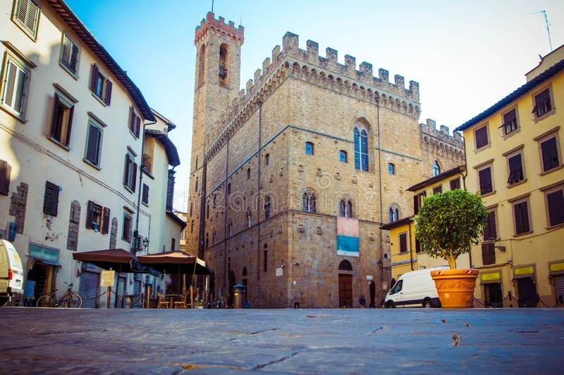 Panoramic view of famous Palazzo Vecchio, old houses and cobbled streets in Florence, Tuscany, Italy stock image