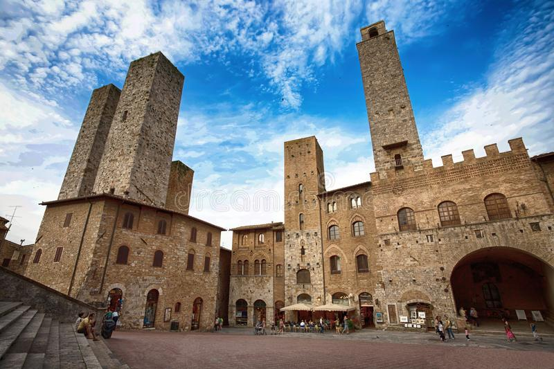 Panoramic view of famous Piazza del Duomo in San Gimignano , Siena province, Tuscany, Italy. stock photo