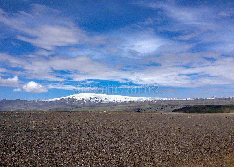 Panoramic view on famous volcano Eyjafjallajokull, Solheimasandur plane wreck place: black sand desert landscape in South Iceland, royalty free stock photography
