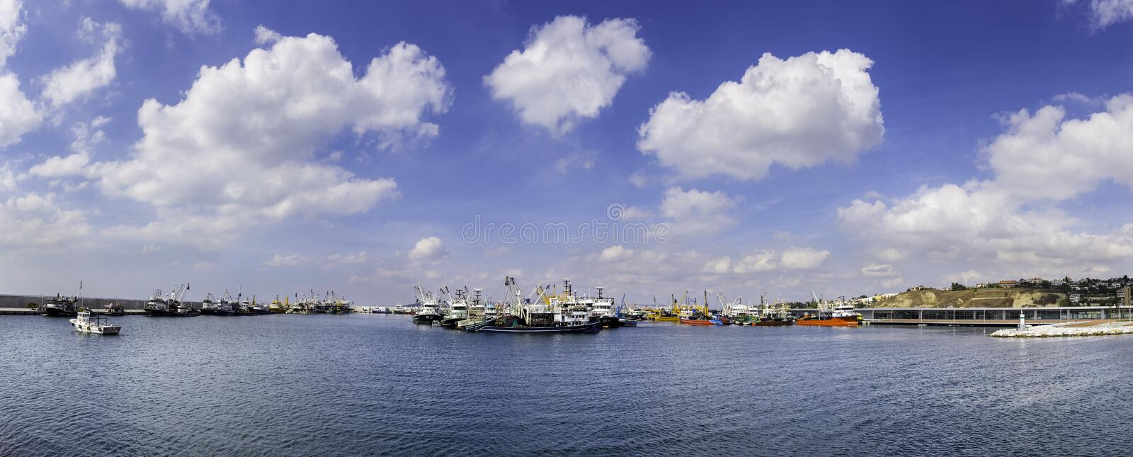 Panoramic view of fish trawler and fishing boats in new Buyukcekmece fishing port in Istanbul. Turkey 2015 stock photography