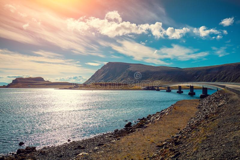 Bridge over the fjord on the way to Nordkapp. Island of Mageroya, Norway. Panoramic view at fjord with the bridge. Beautiful nature Norway. Arctic Bay. Mageroya royalty free stock photography