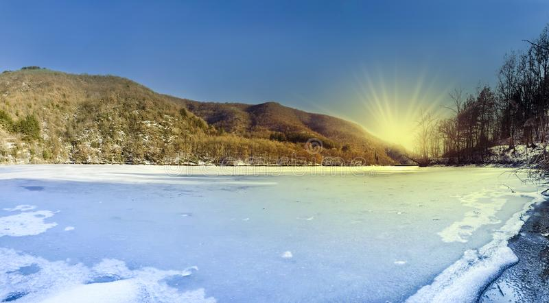 Panoramic view of frozen lake royalty free stock image