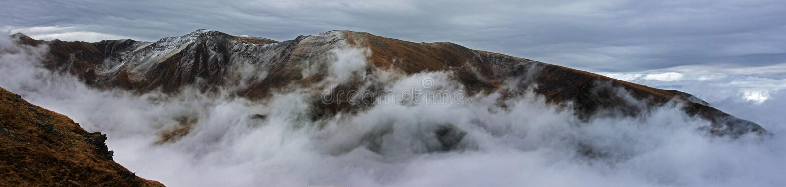 Panoramic view of a frozen mountain in Romania stock images