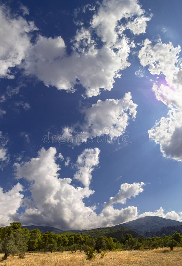 Panoramic view of Giant Cumulus clouds before the approaching summer storm in a village on the Greek island of Evia royalty free stock photography