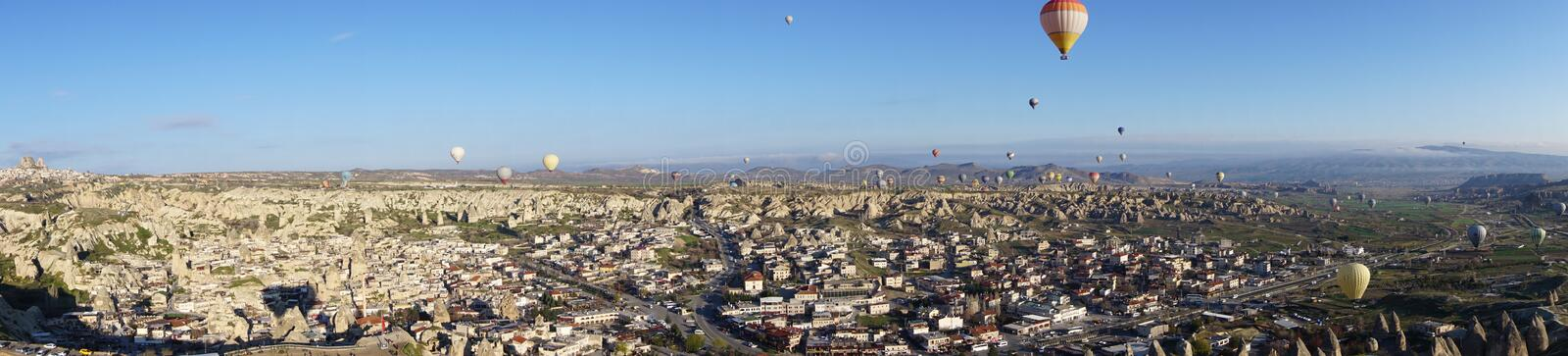 Panoramic view of Goreme beautiful landscape with hot air balloon floating in the sky. In the morning stock image