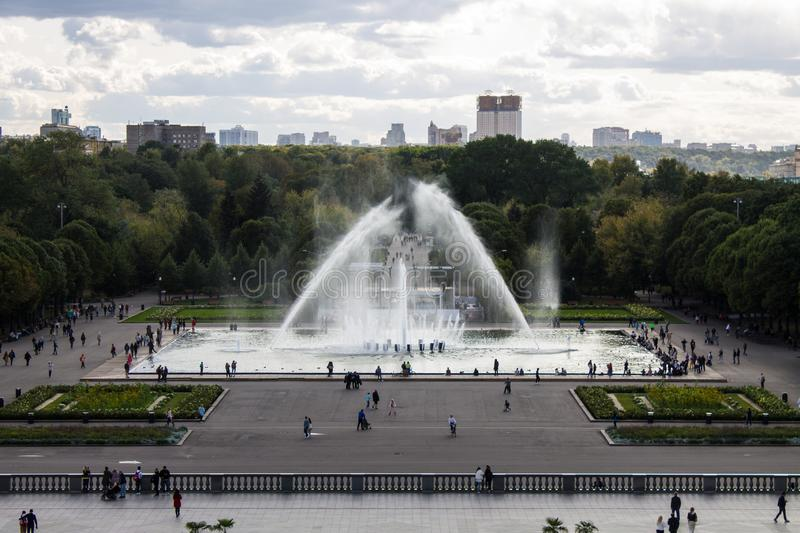 Panoramic view of the Gorky Park with a fountain and flowerbeds cloud on a summer day. With its historic architecture in the background royalty free stock photography
