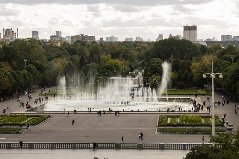 Panoramic view of the Gorky Park with a fountain and flowerbeds cloud on a summer day. With its historic architecture in the background royalty free stock photo
