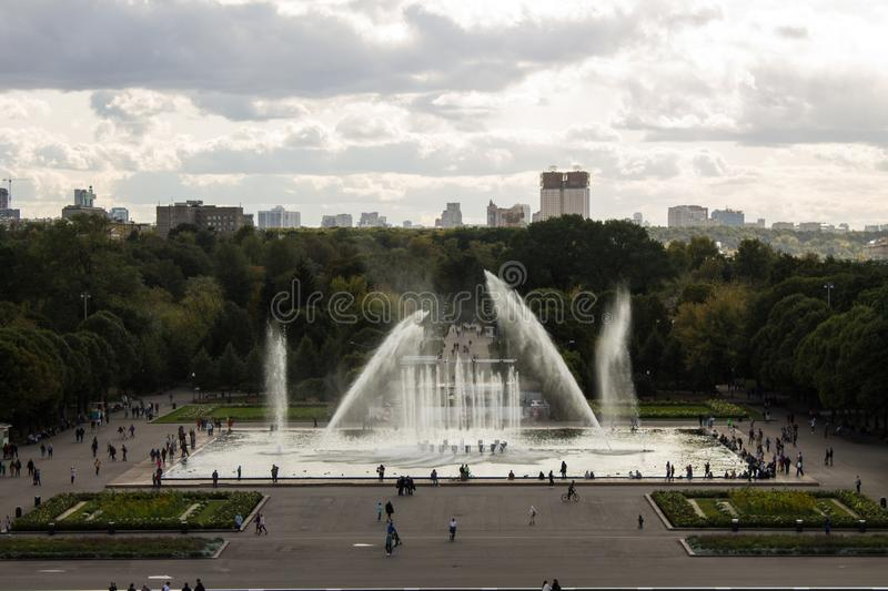 Panoramic view of the Gorky Park with a fountain and flowerbeds cloud on a summer day. With its historic architecture in the background royalty free stock images