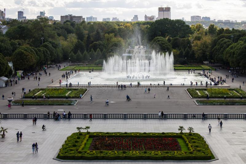 Panoramic view of the Gorky Park with a fountain and flowerbeds cloud on a summer day. With its historic architecture in the background stock photos