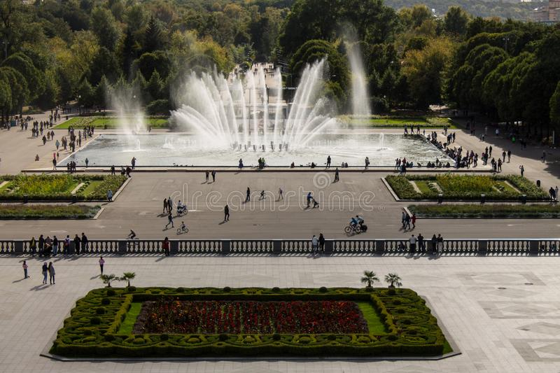 Panoramic view of the Gorky Park with a fountain and flowerbeds cloud on a summer day. With its historic architecture in the background stock image