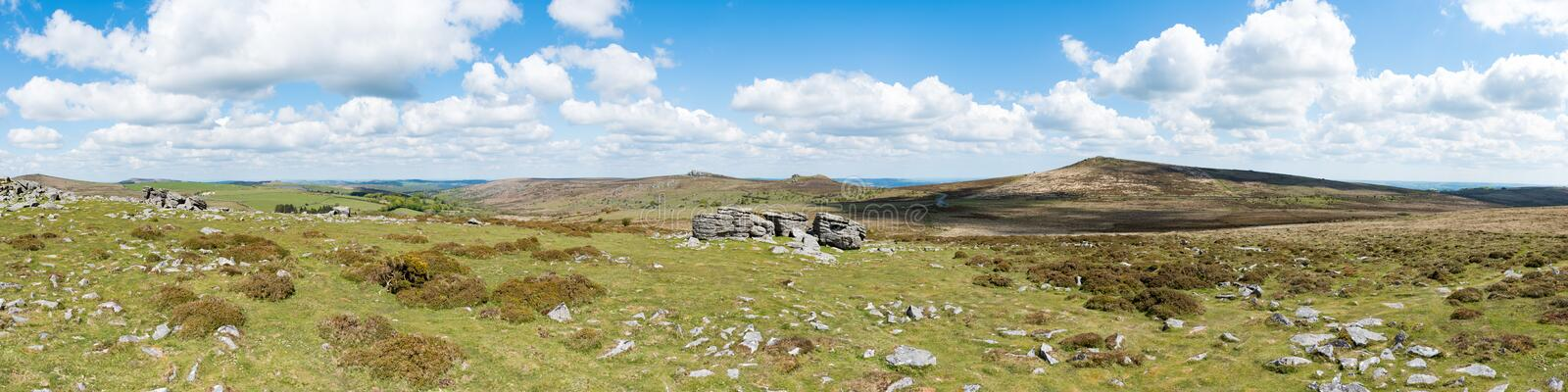 Panoramic view of the granite bedrock outcrops at Top Tor, Dartmoor National Park, Devon, UK, on a bright cloudy day royalty free stock image