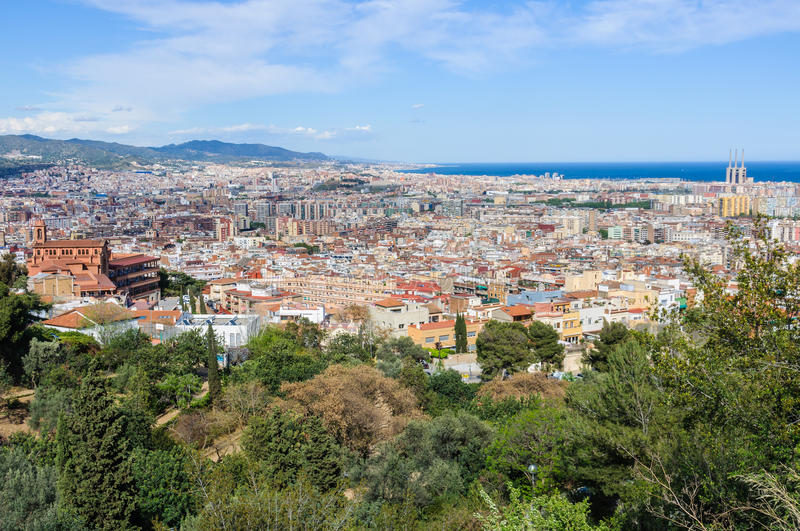Panoramic view from Guinardo Park in Barcelona, Spain. The skyline of Barcelona from the hill of Turo del Rovira in Barcelona, Catalonia, Spain royalty free stock image