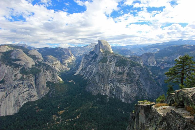 Panoramic view of Half Dome, El Capitan and other mountains in the Yosemite National Park, California, USA stock photography
