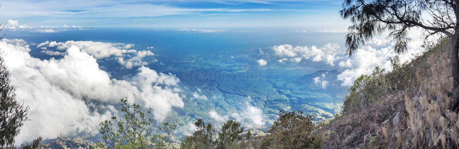 Panoramic view from a height. Panoramic view of the hills of the volcano Agung. Blue sky panorama with clouds stock image