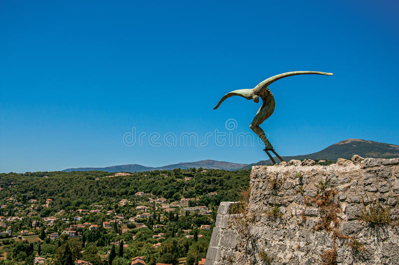 Panoramic view of hills and sculpture in Saint-Paul-de-Vence. stock photography