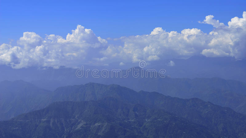 Panoramic view of Himalayan Mountain Range with Blue sky and Clouds. High resolution image of Himalayan Dhauladhar mountain range seen from dalhousie India stock photography