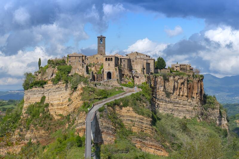 Panoramic view of historic town of Civita di Bagnoregio with surrounding hills and valleys of Lazio, Civita di Bagnoregio, Italy.  royalty free stock image