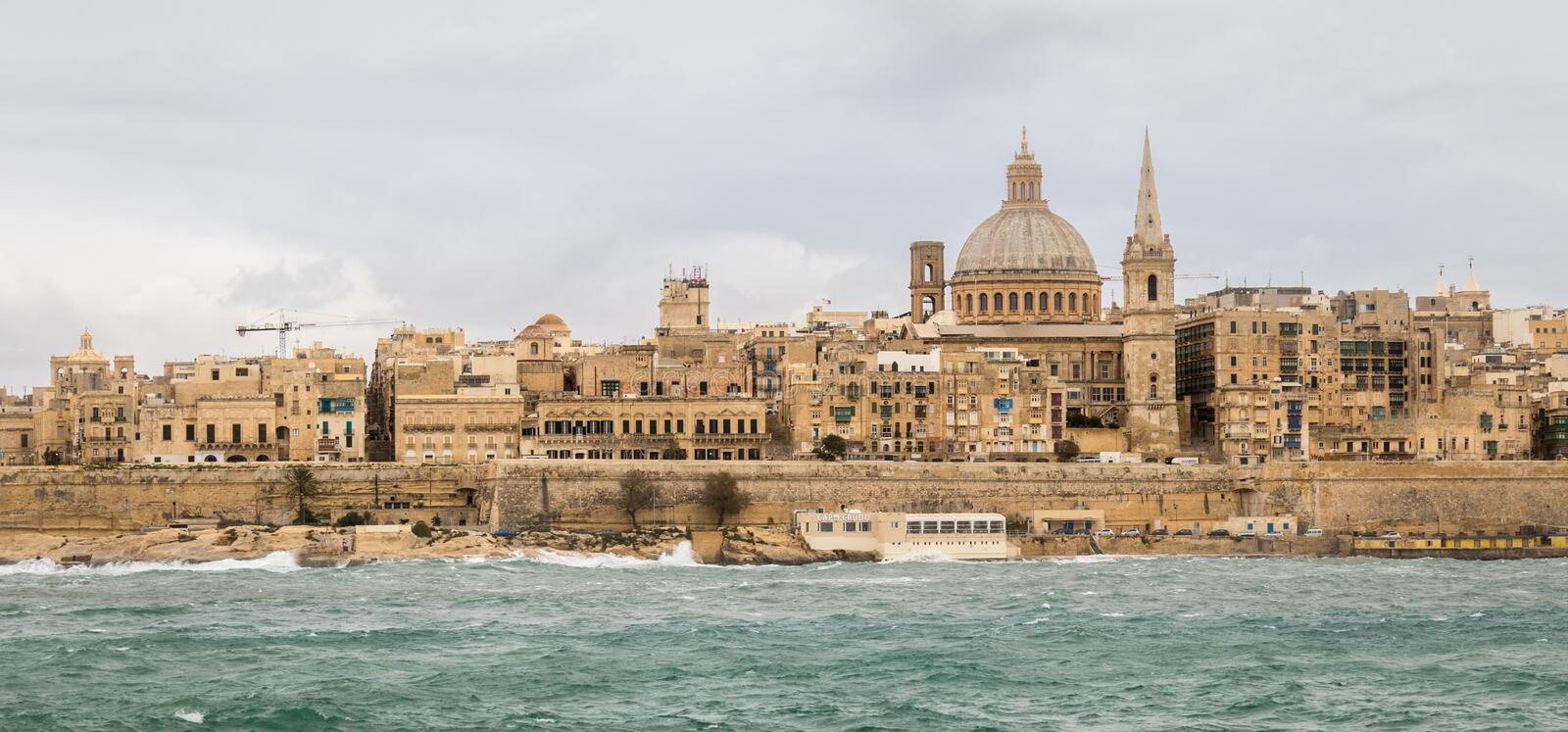 Panoramic View on the Skyline of historical Valletta during a stormy day royalty free stock image
