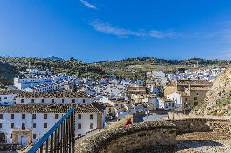 Panoramic view of houses and white buildings with a hill in the background. Seen from a viewpoint in the city of Antequera, wonderful and sunny day with a blue stock image